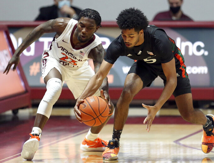 Virginia Tech's Tyrece Radford (23) tries to get the ball from Miami's Harlond Beverly (5) during the first half of an NCAA college basketball game, Tuesday, Dec. 29, 2020 in Blacksburg, W.Va. (Matt Gentry/The Roanoke Times via AP, Pool)