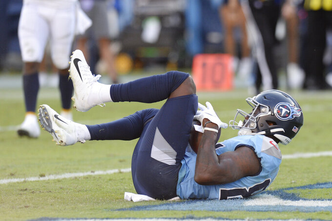 Tennessee Titans wide receiver Corey Davis catches a touchdown pass against the Los Angeles Chargers in the first half of an NFL football game Sunday, Oct. 20, 2019, in Nashville, Tenn. (AP Photo/Mark Zaleski)