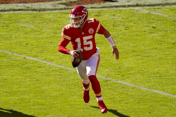 Kansas City Chiefs quarterback Patrick Mahomes (15) scrambles out of the pocket before throwing a pass in the second half of an NFL football game against the New York Jets on Sunday, Nov. 1, 2020, in Kansas City, Mo. (AP Photo/Charlie Riedel)