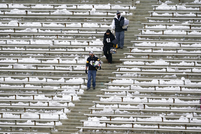 Fans walk down steps in Kinnick Stadium before an NCAA college football game between Iowa and Wisconsin, Saturday, Dec. 12, 2020, in Iowa City, Iowa. (AP Photo/Charlie Neibergall)