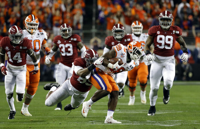 Clemson's Tavien Feaster is stopped during the first half the NCAA college football playoff championship game against Alabama, Monday, Jan. 7, 2019, in Santa Clara, Calif. (AP Photo/David J. Phillip)
