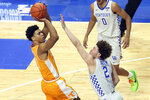 Tennessee's Jaden Springer, left, shoots while defended by Kentucky's Devin Askew during the first half of an NCAA college basketball game in Lexington, Ky., Saturday, Feb. 6, 2021. (AP Photo/James Crisp)