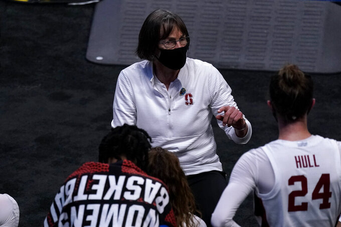 Stanford head coach Tara VanDerveer talks to her players during the second half of a college basketball game against Utah Valley in the first round of the women's NCAA tournament at the Alamodome in San Antonio, Sunday, March 21, 2021. (AP Photo/Charlie Riedel)