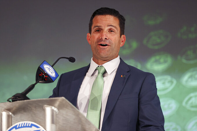 Miami head coach Manny Diaz answers a question during the NCAA college football Atlantic Coast Conference media days in Charlotte, N.C., Wednesday, July 21, 2021. (AP Photo/Nell Redmond)