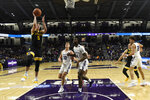 Iowa guard CJ Fredrick (5) shoots as Northwestern forward Jared Jones (4) stands nearby during the second half of an NCAA college basketball game Tuesday, Jan. 14, 2020, in Evanston, Ill. (AP Photo/David Banks)