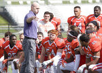In this image provided by Hobart and William Smith Colleges, Hobart head coach Kevin DeWall addresses his team following the Statesmen's 33-7 win over No. 13 Brockport to open the 2019 season on Sept. 7, 2019, in Geneva, N.Y. There will be no pregame Victory Walk or singing of the alma mater after wins at Hobart College's 3,000-seat Boswell Field this fall. The coronavirus pandemic has led to the cancellation or postponement of more than 1,800 games across the NCAA, more than 1,000 in Division III. (Mary Mazzarella/Hobart and William Smith Colleges via AP)
