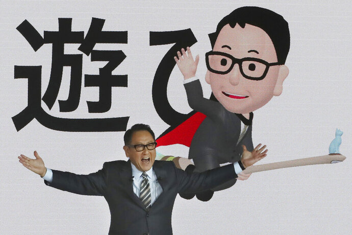 Toyota Motor Corp. President Akio Toyoda speaks during Toyota's presentation of the media preview of the Tokyo Motor Show in Tokyo Wednesday, Oct. 23, 2019. The Japanese letters in the background read: