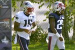 New England Patriots wide receiver N'Keal Harry (15) and defensive back Terrence Brooks (25) step onto the field for an NFL football training camp practice, Monday, Aug. 24, 2020, in Foxborough, Mass. (AP Photo/Steven Senne, Pool)
