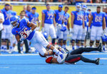 Boise State tight end Chase Blakley, left, is tackled after a reception by a San Diego State defender in the first half of an NCAA college football game, Saturday, Oct. 6, 2018, in Boise, Idaho. (AP Photo/Steve Conner)
