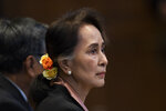 Myanmar's leader Aung San Suu Kyi sits in the court room of the International Court of Justice for the first day of three days of hearings in The Hague, Netherlands, Tuesday, Dec. 10, 2019. Aung San Suu Kyi will represent Myanmar in a case filed by Gambia at the ICJ, the United Nations' highest court, accusing Myanmar of genocide in its campaign against the Rohingya Muslim minority. (AP Photo/Peter Dejong)