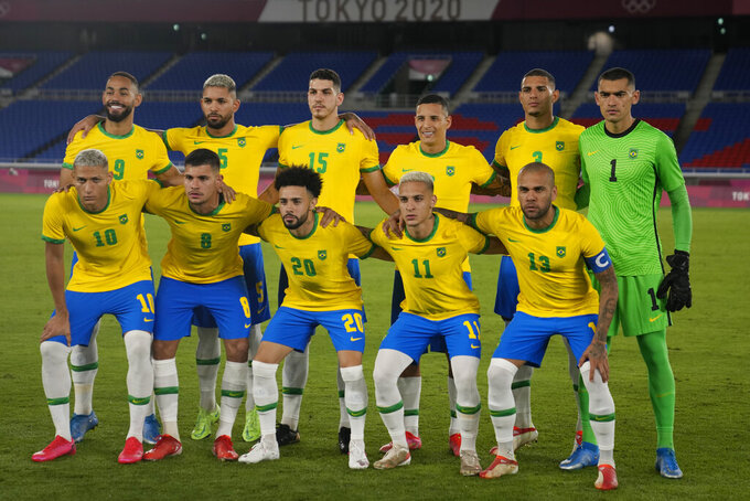 Players of Brazil pose for the group photo prior to their men's soccer match against Germany at the 2020 Summer Olympics, Thursday, July 22, 2021, in Yokohama, Japan. (AP Photo/Kiichiro Sato)