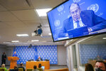 Russian Foreign Minister Sergey Lavrov is seen on a video screen as he speaks to reporters during a news conference during 76th session of the United Nations General Assembly, Saturday, Sept. 25, 2021 at United Nations headquarters. (AP Photo/Mary Altaffer)