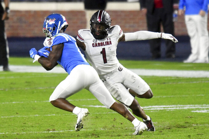 Mississippi wide receiver Elijah Moore is tackled by South Carolina defensive back Jaycee Horn (1) during the first half of an NCAA college football game in Oxford, Miss., Saturday, Nov. 14, 2020. (AP Photo/Bruce Newman)