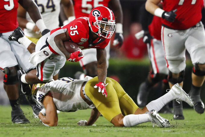 Georgia running back Brian Herrien (35) runs against Notre Dame during the second half of an NCAA college football game, Saturday, Sept. 21, 2019, in Athens, Ga. Georgia won 23-17. (AP Photo/John Bazemore)