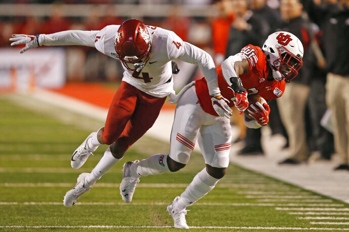 Utah running back Devonta'e Henry-Cole, right, carries the ball as Washington State cornerback Marcus Strong (4) defends in the second half of an NCAA college football game Saturday, Sept. 28, 2019, in Salt Lake City. (AP Photo/Rick Bowmer)