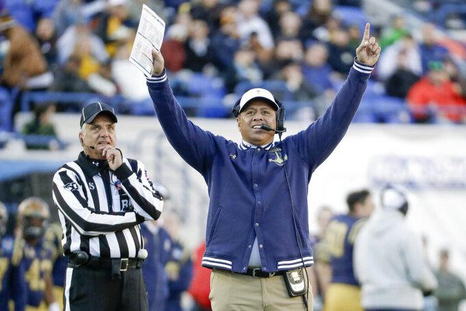 Navy head coach Ken Niumatalolo watches a replay in the first half of the Liberty Bowl NCAA college football game between Navy and Kansas State Tuesday, Dec. 31, 2019, in Memphis, Tenn. (AP Photo/Mark Humphrey)