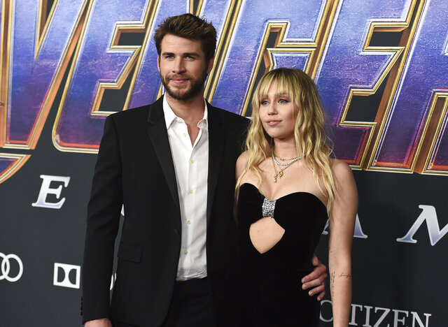 FILE - This April 22, 2019 file photo shows Liam Hemsworth, left, and Miley Cyrus arrive at the premiere of