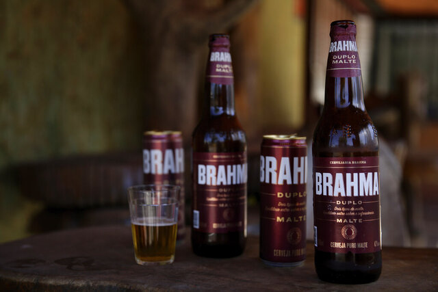 Brahma beer is displayed at a bar that's open for deliveries only amid the COVID-19 pandemic in Brasilia, Brazil, Tuesday, July 14, 2020. An interfaith coalition is pressuring the world's largest brewer to remove the name of the Hindu god, saying the name is offensive to Hindus, who worship Lord Brahma, the religion's god of creation. An Anheuser-Busch InBev brewery spokesman says the beer actually was named to honor Joseph Bramah, an Englishman who invented the draft pump handle, and the spelling was changed to adapt the name to the Portuguese language. (AP Photo/Eraldo Peres)