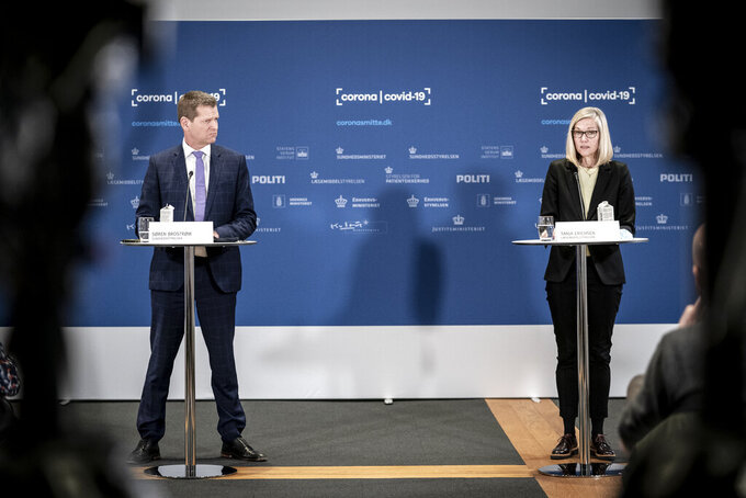 Soeren Brostroem, director of the National Board of Health, left and Tanja Erichsen, from the Danish Medicines Agency take part in a press briefing regarding the status of the AstraZeneca COVID-19 vaccine, in Copenhagen, Thursday, March 25, 2021. Danish officials have decided to extend their suspension of the AstraZeneca COVID-19 vaccine by three weeks while they continue evaluating the vaccine's potential link with blood clots. Denmark first paused the use of the AstraZeneca vaccine as a precautionary measure on March 11. (Mads Claus Rasmussen/Ritzau Scanpix via AP)