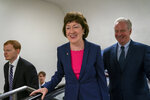 Sen. Susan Collins, R-Maine, joined by Sen. Tim Kaine, D-Va., right, arrives at the Capitol to extend her perfect Senate voting record to 7,000, as she prepares for a 2020 campaign, in Washington, Tuesday, June 18, 2019. (AP Photo/J. Scott Applewhite)