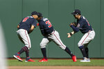 Atlanta Braves outfielders Eddie Rosario (8), Guillermo Heredia (38) and Adam Duvall celebrate their victory over the San Francisco Giants in a baseball game, Sunday, Sept. 19, 2021, in San Francisco. (AP Photo/D. Ross Cameron)