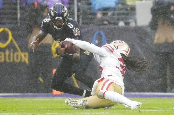 San Francisco 49ers defensive back Marcell Harris (36) strips the ball from Baltimore Ravens quarterback Lamar Jackson (8) to cause a fumble in the second half of an NFL football game, Sunday, Dec. 1, 2019, in Baltimore, Md. (AP Photo/Julio Cortez)