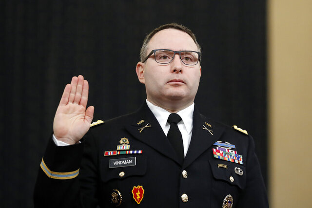 FILE - In this Nov. 19, 2019, file photo National Security Council aide Lt. Col. Alexander Vindman is sworn in to testify before the House Intelligence Committee on Capitol Hill in Washington during a public impeachment hearing of President Donald Trump's efforts to tie U.S. aid for Ukraine to investigations of his political opponents. Vindman was escorted out of the White House complex on Friday, Feb. 7, 2020, according to his lawyer. (AP Photo/Andrew Harnik, File)