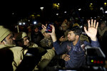 An Indian student, bleeding from head, raises his hands as he is detained by police during a protest march towards the presidential palace against a recent attack on students by masked men inside Jawaharlal Nehru University, in New Delhi, India, Thursday, Jan. 9, 2020. The protest march Thursday of students and faculty of the esteemed university in New Delhi that was the site of a mob attack earlier this week was violently broken up by police, with police wielding batons to force demonstrators onto buses. (AP Photo/Altaf Qadri)
