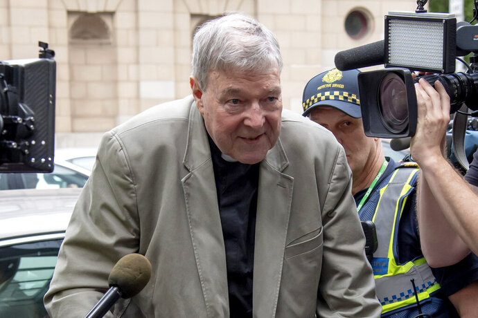 FILE - In this Feb. 26, 2019, file photo, Cardinal George Pell arrives at the County Court in Melbourne, Australia. Australia's highest court agreed Wednesday Nov. 13, 2019, to hear an appeal from the most senior Catholic to be found guilty of sexually abusing children, giving Cardinal George Pell his last chance at getting his convictions overturned.(AP Photo/Andy Brownbill, File)