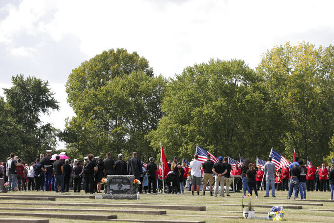 """Mourners gather at Mount Hope cemetery for the funeral of Marine Cpl. Humberto """"Bert"""" Sanchez, Tuesday, Sept. 14, 2021 in Logansport, Ind. Sanchez was one of 13 U.S. service members to die in an explosion during evacuation efforts in Afghanistan. (Nikos Frazier/Journal & Courier via AP)"""