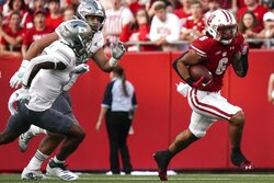 Wisconsin's Chez Mellusi runs during the first half of an NCAA college football game against Eastern Michigan Saturday, Sept. 11, 2021, in Madison, Wis. (AP Photo/Morry Gash)