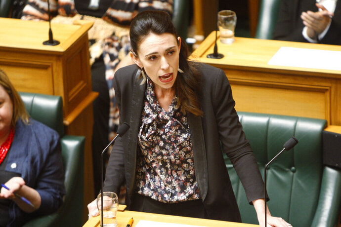 New Zealand Prime Minister Jacinda Ardern talks in Parliament in Wellington, New Zealand Thursday, Nov. 7, 2019. New Zealand lawmakers joined forces across the aisle to pass a bill aimed at combating climate change. (AP Photo/Nick Perry)