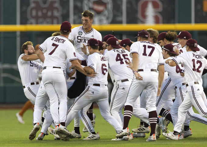 Mississippi State players celebrate their walk-off run to win against Texas during a baseball game in the College World Series Saturday, June 26, 2021, at TD Ameritrade Park in Omaha, Neb. (AP Photo/Rebecca S. Gratz)