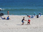 This Sept. 27, 2021, photo shows people on the beach in Deal, N.J. Deal is one of three Jersey Shore towns that will share a $26 million beach replenishment project starting in November. (AP Photo/Wayne Parry)