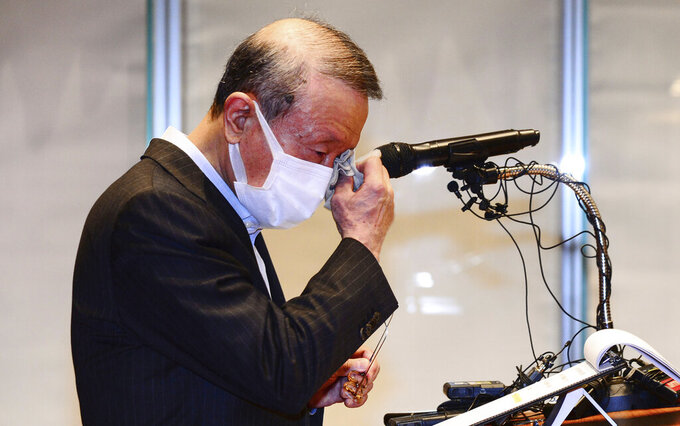 Hong Won-sik, chairman of Namyang Dairy Products, wipes his tears during a press conference at the company's headquarters in Seoul, South Korea, Tuesday, May 4, 2021. Hong resigned over a scandal in which his company was accused of deliberately spreading misinformation that its yogurt helps prevent coronavirus infections. (Hwang Gang-mo/Yonhap via AP)
