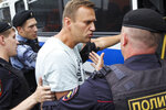 Russian police detain opposition leader Alexei Navalny, during a march in Moscow, Russia, Wednesday, June 12, 2019. Police and hundreds of demonstrators are facing off in central Moscow at an unauthorized march against police abuse in the wake of the high-profile detention of a Russian journalist. More than 20 demonstrators have been detained, according to monitoring group. (Artemie Mindrin,Rain TV Channel via AP)
