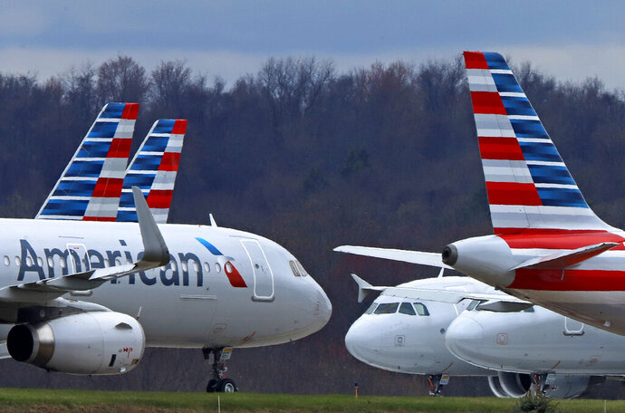 FILE - In this March 31, 2020 file photo American Airlines planes are parked at Pittsburgh International Airport in Imperial, Pa. Shares of American Airlines posted a record percentage gain Thursday, June 4, 2020 after the carrier said it will aggressively add back flights in July — a bet that the slow recovery in air travel will gain speed this summer as states re-open their economies. (AP Photo/Gene J. Puskar, file)