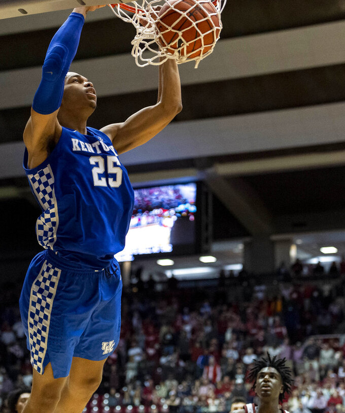 Kentucky forward PJ Washington (25) slams two points against Alabama during the second half of an NCAA college basketball game, Saturday, Jan. 5, 2019, in Tuscaloosa, Ala. (AP Photo/Vasha Hunt)