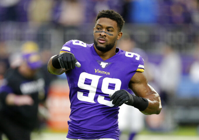 FILE - In this Dec. 29, 2019, file photo, Minnesota Vikings defensive end Danielle Hunter warms up before the team's NFL football game against the Chicago Bears in Minneapolis. Hunter does not appear close to returning to the team. Coach Mike Zimmer said the two-time Pro Bowl pick was in New York for a second medical opinion on his reported neck injury. Hunter was placed on injured reserve Sept. 9. (AP Photo/Andy Clayton-King, File)