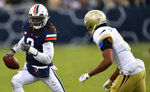 Virginia quarterback Bryce Perkins (3) runs against Georgia Tech defensive back Lamont Simmons (6) during the first half of an NCAA football game, Saturday, Nov. 17, 2018, in Atlanta. (AP Photo/Mike Stewart)