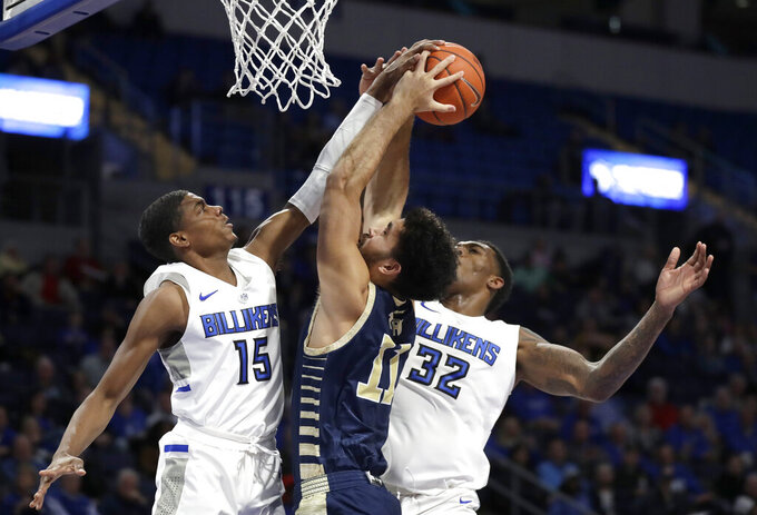 FILE - In this Jan. 8, 2020, file photo, George Washington's Arnaldo Toro (11) heads to the basket as Saint Louis' Demarius Jacobs (15) and Jimmy Bell Jr. (32) defend during the first half of an NCAA college basketball game in St. Louis. St. John's signed Toro on Thursday, April 16, as a graduate transfer from George Washington. After spending four years at George Washington, he will be eligible to play for the Red Storm immediately. (AP Photo/Jeff Roberson, File)