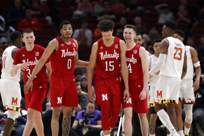 Nebraska's Thorir Thorbjarnarson (34), James Palmer Jr. (0), is Isaiah Roby (15) and Johnny Trueblood (4) celebrates during the second half of an NCAA college basketball game against the Maryland in the second round of the Big Ten Conference tournament, Thursday, March 14, 2019, in Chicago. The Nebraska won 69-61. (AP Photo/Nam Y. Huh)