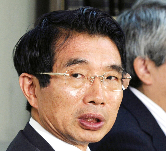 """In this May 9, 2012, photo, lawyer Junichiro Hironaka speaks at the press cub of courthouse in Tokyo. The newly appointed star defender for former Nissan chairman Carlos Ghosn said Wednesday, Feb. 20, 2019 he believes the case against his client does """"not meet international standards."""" Hironaka also said that he believed Ghosn's trial on charges of falsifying financial reporting and breach of trust might not begin until after the summer. (Kyodo News via AP)"""