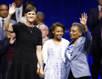 Mayor of Chicago Lori Lightfoot, right, is joined on stage with her spouse Amy Eshleman, left, and her daughter Vivian during her inauguration ceremony Monday, May 20, 2019, in Chicago. (AP Photo/Jim Young)