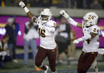 Arizona State's Aashari Crosswell, left, celebrates with Chase Lucas (24) after intercepting a pass intended for California's Jordan Duncan in the first half of an NCAA college football game, Friday, Sept. 27, 2019, in Berkeley, Calif. (AP Photo/Ben Margot)