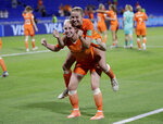 Netherlands' Inessa Kaagman and Jackie Groenen celebrate after their team's 1-0 win over Sweden to win their Women's World Cup semifinal soccer match between the Netherlands and Sweden at Stade de Lyon outside Lyon, France, Wednesday, July 3, 2019. (AP Photo/Alessandra Tarantino)