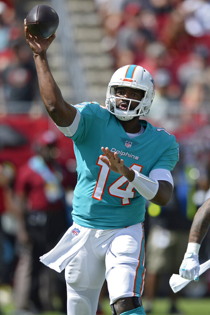 Miami Dolphins quarterback Jacoby Brissett (14) throws a pass against the Tampa Bay Buccaneers during the first half of an NFL football game Sunday, Oct. 10, 2021, in Tampa, Fla. (AP Photo/Jason Behnken)