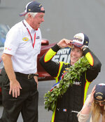 Simon Pagenaud, of France, talks with car owner Roger Penske as they celebrate on the Yard of Bricks after Pagenaud won the Indianapolis 500 IndyCar auto race at Indianapolis Motor Speedway, Sunday, May 26, 2019, in Indianapolis. (AP Photo/AJ Mast)