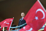 Turkey's President Recep Tayyip Erdogan attends a graduation ceremony of a military academy in Istanbul, Saturday, Aug. 31, 2019. Erdogan said the U.S. had up to three weeks to satisfy Turkish demands and has threatened to launch a unilateral offensive into northeastern Syria if plans to establish a so-called safe zone along Turkey's border fail to meet his expectations. Earlier this month, Turkish and U.S. officials agreed to set up the zone east of the Euphrates River. (Presidential Press Service via AP, Pool)