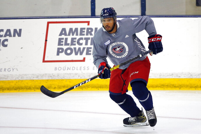 FILE - In this July 20, 2020, file photo, Columbus Blue Jackets' Seth Jones skates  during the NHL hockey team's practice in Columbus, Ohio. Jones, Pittsburgh forward Jake Guentzel and Tampa Bay captain Steven Stamkos would've missed some or all of the playoffs if they started in April. Instead, the silver lining of the COVID-19 pandemic halting the season is those players are healthy and ready to contribute.  (AP Photo/Jay LaPrete, File)